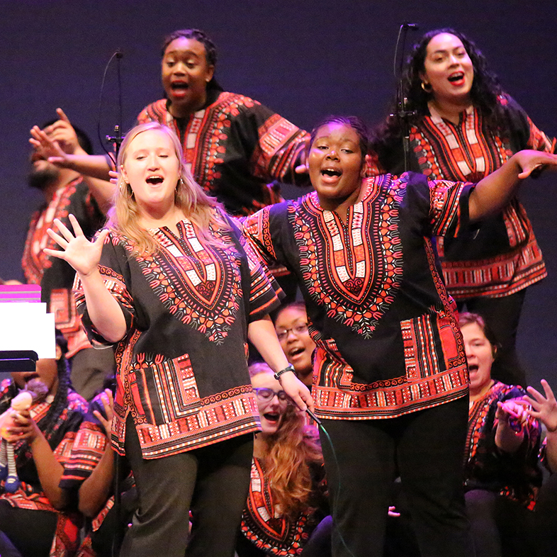Photo of a group of female vocalists in the African American Choral Ensemble.