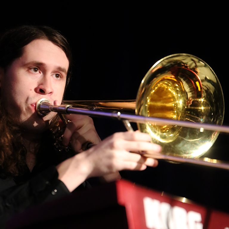 Photo of a male trombone player during an IU Soul Revue concert.