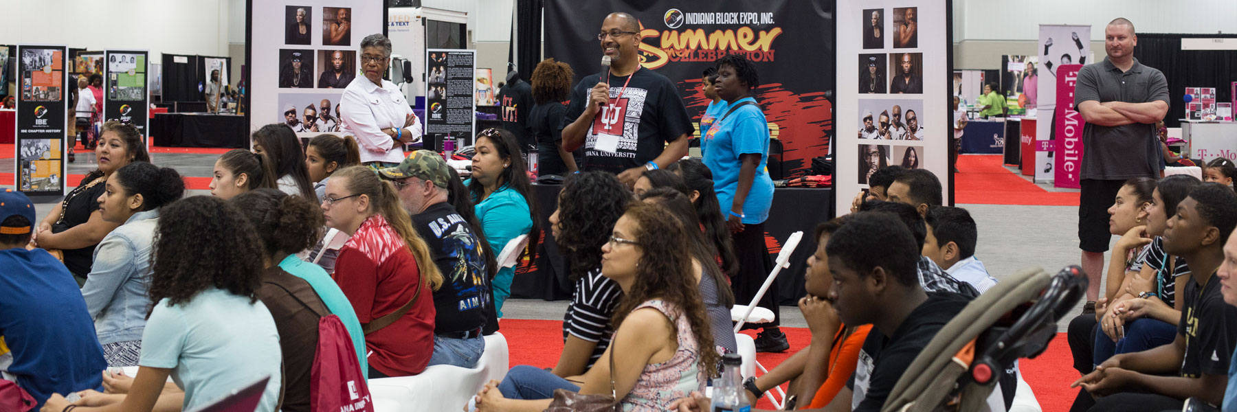 A presenter speaks to students during the Indiana Black Expo Summer Celebration.