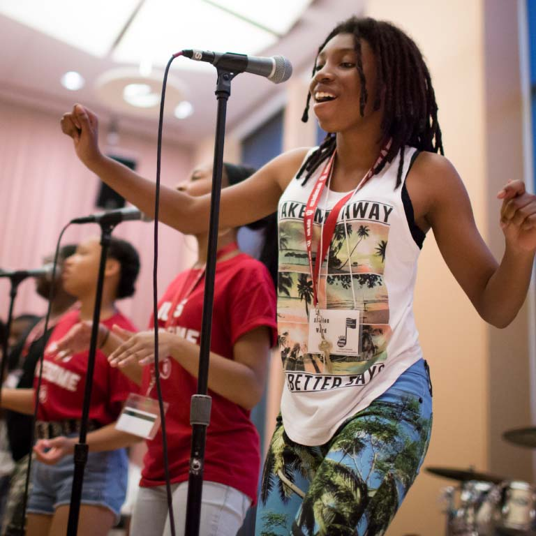A woman sings at an event at the Neal-Marshall Black Culture Center.