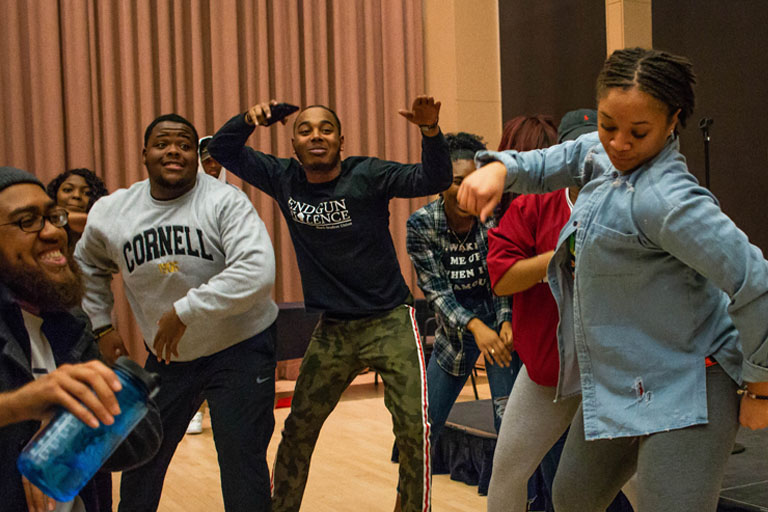 Students dancing at black knowledge bowl
