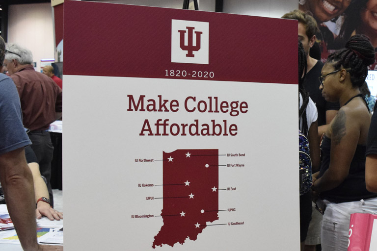 Poster at IBE with text Make College Affordable