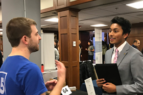 Student speaking with a recruiter at the Diversity Career Fair.