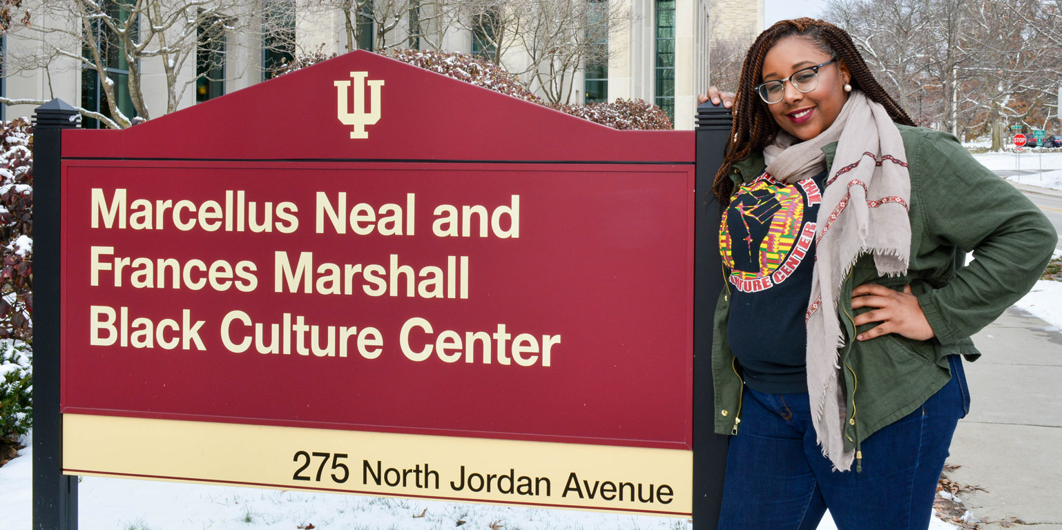 NMBCC student worker Lauren Blackwell standing in front of the NMBCC sign