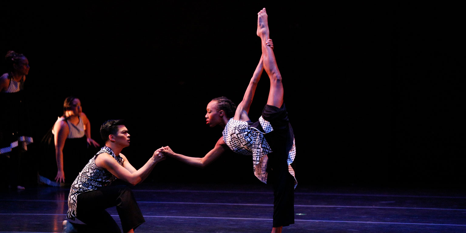 African American Dance company members perform on stage