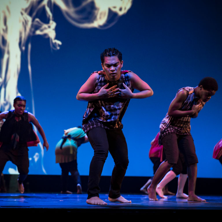 Kelvin Burzon performs on stage with the African American Dance Company.