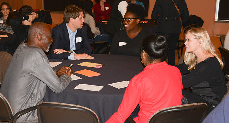 Students and faculty mentors chat at a faculty mentoring meet-and-greet.