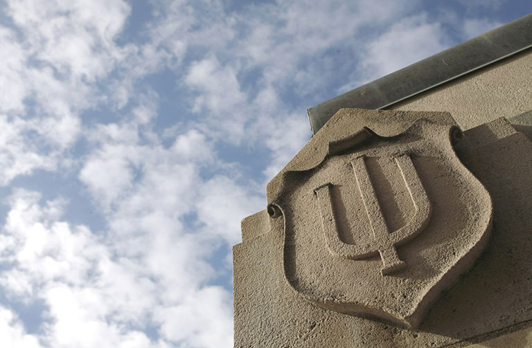 The IU trident in stone
