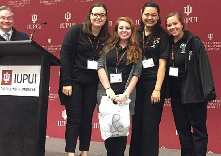 fase iupui symposium poster winners stand together