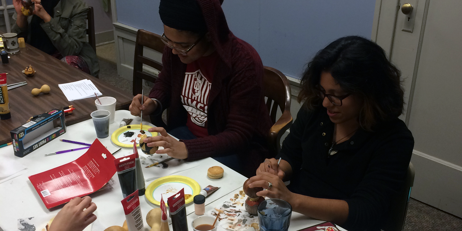 Students paint during La Casa's Wellness and Culture Talking Circle series.